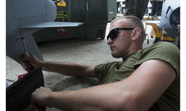 Lance Cpl. Cody Winsor prepares ordnance for units participating in Valiant Shield 16 at Andersen Air Force Base on September 12. Photo by Sgt. Justin A. Fisher, U.S. Marine Corps