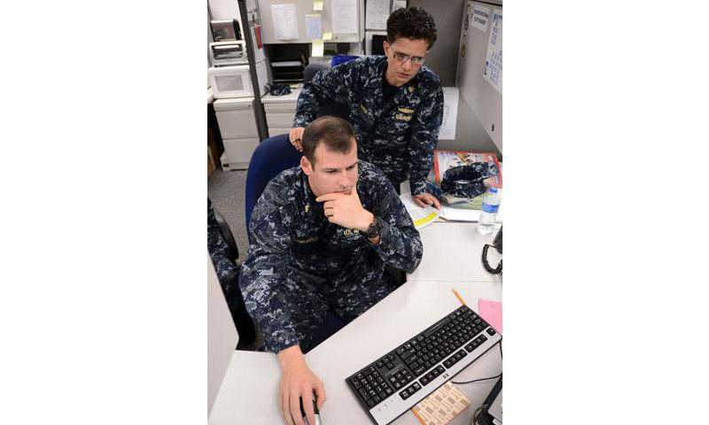 Chief Warrant Officer Liz Rivera, combat systems rating assignment officer at Navy Personnel Command, trains Chief Firecontrolman Mike Zdunkawicz on how to use the Enlisted Assignment Information System (EAIS). Detailers use EAIS in conjunction with Career Management System/Interactive Detailing to post Sailors to billets. (U.S. Navy photo by Mass Communication Specialist 2nd Class Andrea Perez/Released)