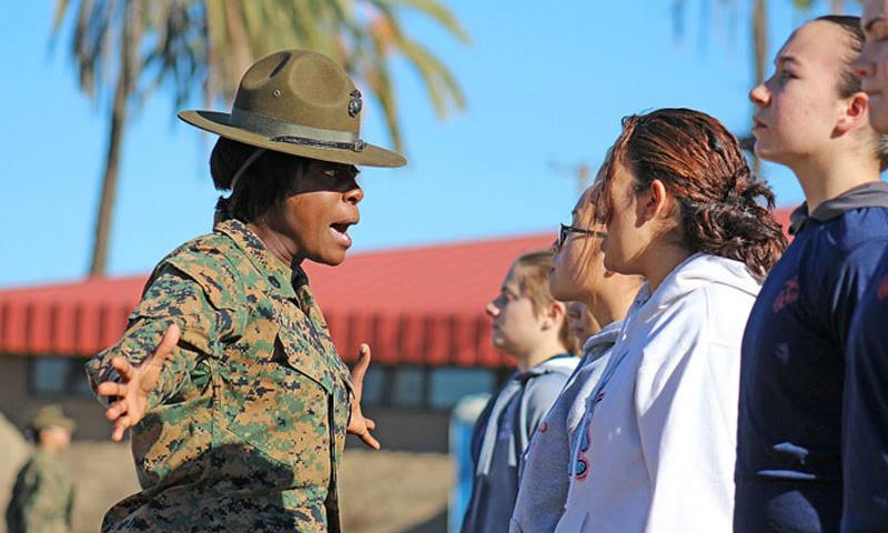 A Marine Corps drill instructor corrects a Marine enlistee on Dec. 12, 2015, during training at Marine Corps Base Camp Pendleton, Calif. In a Jan. 1, 2016, memo, Secretary of the Navy Ray Mabus instructed the Marine Corps to end gender-segregated initial training by April. (Alicia R. Leaders/U.S. Marine Corps)