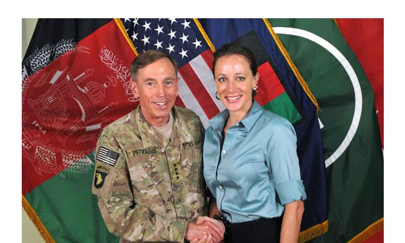 This July 13, 2011, photo made available on the International Security Assistance Force's Flickr website shows the former Commander of ISAF and U.S. Forces-Afghanistan Gen. David Petraeus, left, shaking hands with his biographer Paula Broadwell, with whom he had an extramarital affair. (ISAF)