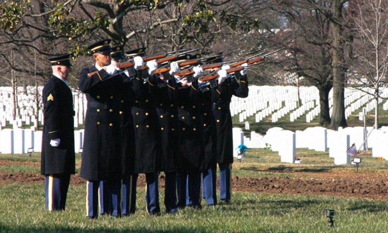A firing party fires three rifle volleys at a funeral at Arlington National Cemetery on March 27, 2013. A funeral service for veteran Harold Raynorhim on Dec. 17, 2016 was missing the blast of the rifle volley and color guard that his 20 years in the Navy warranted, said his son, Michael Raynor. (C.J. Lin/Stars and Stripes)