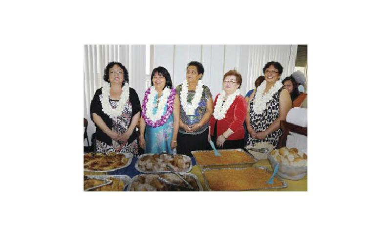 Retirees: From left: Vicky Camacho, Lillian Gumabon, Lillian Chargualaf, Tess Matanane and Gloria Perez  of U.S. Naval Hospital Guam open the table during their retirement ceremony at the hospital in Agana Heights Dec. 28. The women retired with 108 collective years of civilian service. U.S. Navy photo by Hospital Corpsman Finesse Sorrentini/Released