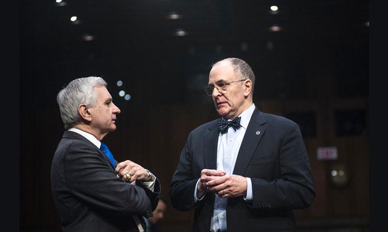 Sen. Jack Reed, D-R.I., speaks with Eliot Cohen, professor of strategic studies at Johns Hopkins School of Advanced International Studies, prior to a Senate Armed Services Committee hearing Tuesday, Jan. 10, 2017, as members considered a proposal to pass a waiver allowing recently retired Gen. James Mattis to become the next secretary of defense. (Carlos Bongioanni/Stars and Stripes)