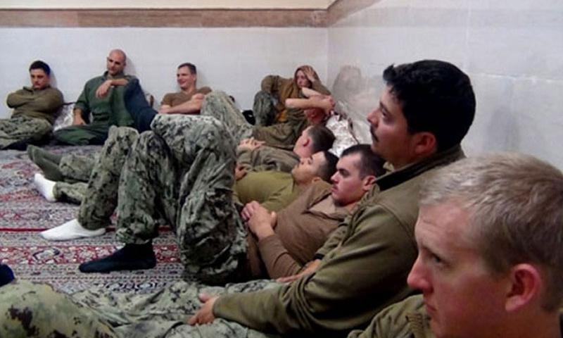 This picture released by the Iranian Revolutionary Guards on Wednesday, Jan. 13, 2016, shows detained American Navy sailors in an undisclosed location in Iran. All 10 of the sailors have been freed. (Sepahnews/AP)