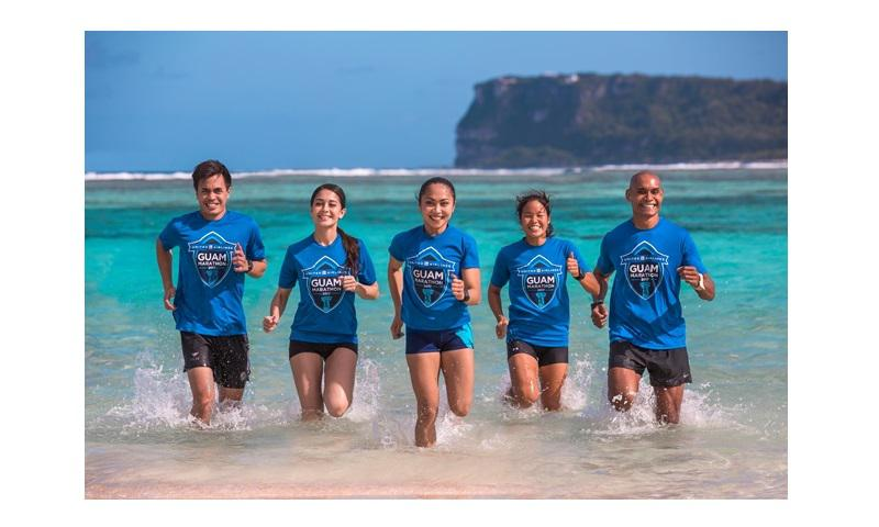 The United Airlines Guam Marathon named Derek Mandell, Rhea Macaluso, Manami Iijima, and Leo Tkel as this year's local event ambassadors. From left: Derek, UGM spokesperson Carmela Tyquiengco, Rhea, Manami and Leo.