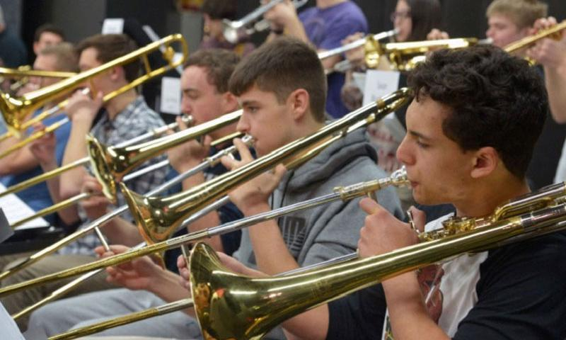 The trombones rehearse a tune at the DODDS-Europe Jazz Seminar at Ramstein Air Base, Germany, Tuesday, Jan. 12, 2016. Thirty-five students from across DODDS-Europe took part in the weeklong seminar. (Michael Abrams/Stars and Stripes)