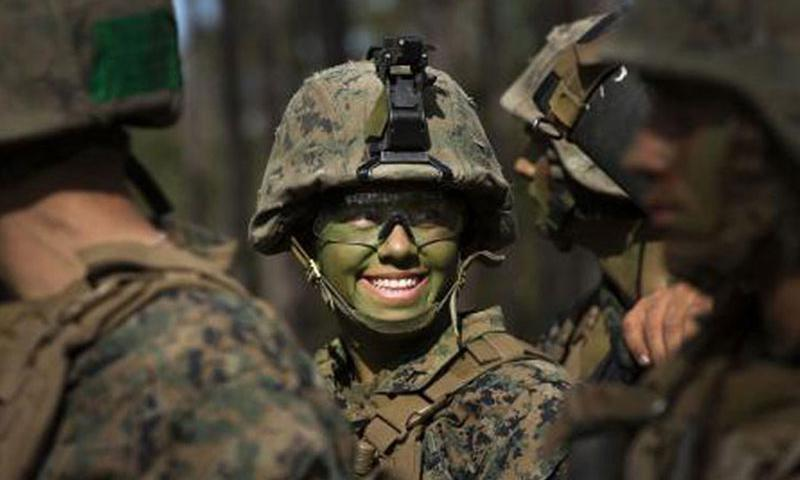 Pfc. Christina Fuentes Montenegro, of Coral Springs, Fla., and other Marines from Delta Company, Infantry Training Battalion, School of Infantry-East, receive final instructions prior to assaulting an objective during the Infantry Integrated Field Training Exercise aboard Camp Geiger, N.C., Nov. 15, 2013. Montenegro was of the first three female Marines to graduate infantry training with the battalion as part of integration study conducted by the service. (Paul Mancuso/U.S. Marine Corps)