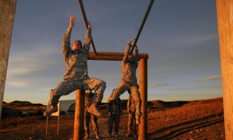 First Lt. Shaye Haver, left, traverses an obstacle during the Ranger Assessment held at Fort Carson on Oct. 24, 2014. (Eric Glassey/Courtesy of the U.S. Army)
