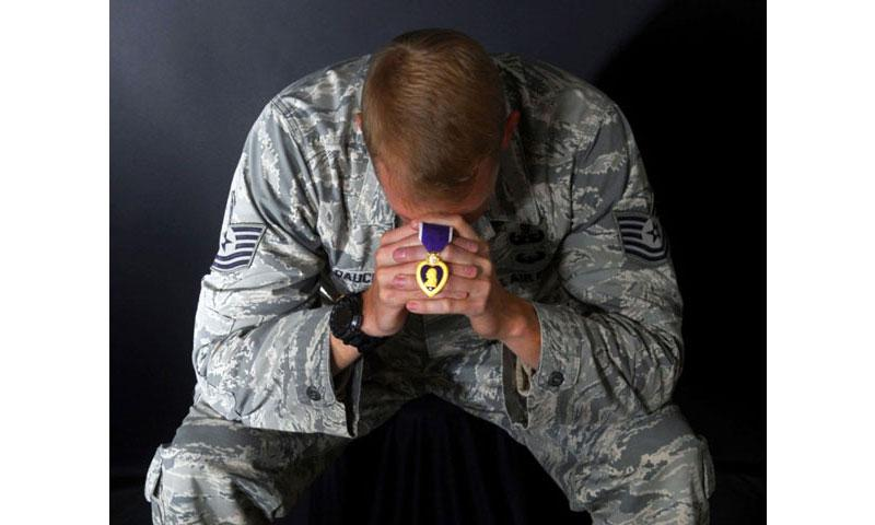 Tech. Sgt. Steven Dauck, 56th Civil Engineer Squadron explosive ordnance disposal team leader, holds the Purple Heart Medal on Nov. 30, 2016, at Luke Air Force Base, Ariz. (Airman 1st Class Alexander Cook/U.S. Air Force)