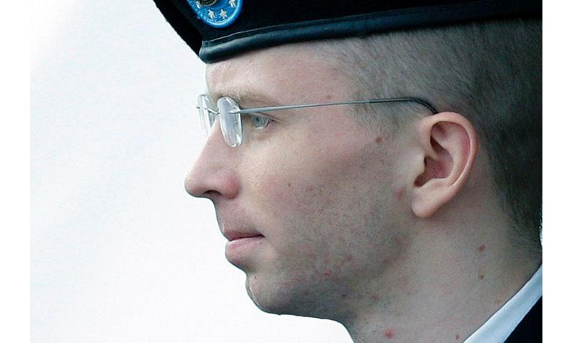 Army Pfc. Bradley Manning, who now wishes to be known as Chelsea Manning, is escorted to a security vehicle outside a courthouse in Fort Meade, Md., on Aug. 20, 2013. Manning will lose military health care benefits under the terms of the sentence that President Obama commuted, according to the Army. (AP)