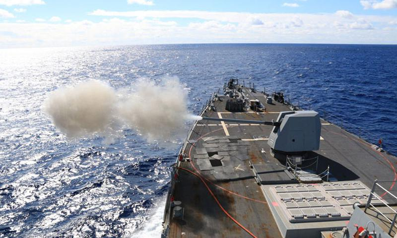 PHILIPPINE SEA (Jan. 17, 2016) The Arleigh Burke-class guided-missile destroyer USS McCampbell (DDG 85) fires a MK 45 5-inch lightweight gun during a live-fire exercise. McCampbell is on patrol in the U.S. 7th Fleet area of operation in support of security and stability in the Indo-Asia-Pacific region. (U.S. Navy photo by Ensign Soon Kwon/Released)