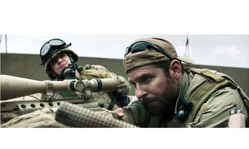 "Kyle Gallner, left, as Goat-Winston and Bradley Cooper as Chris Kyle in Warner Bros. Pictures' and Village Roadshow Pictures' drama ""American Sniper."" (Warner Bros. Pictures/TNS)"