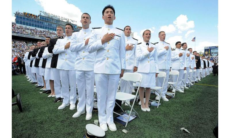Midshipman recite the pledge of allegiance at the U.S. Naval Academy graduation and commissioning ceremonies held at the Navy Marine Corps Memorial Stadium in Annapolis, Md., May 23, 2014. (Lloyd Fox/Baltimore Sun/MCT)