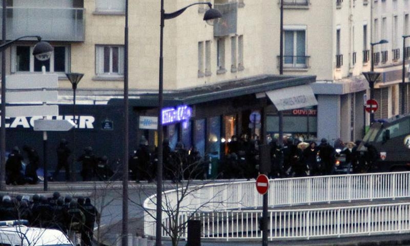 French security forces storm a kosher supermarket in Paris on Friday, Jan. 9, 2015, where a gunman had taken several hostages. (Panoramic/Zuma Press via TNS)
