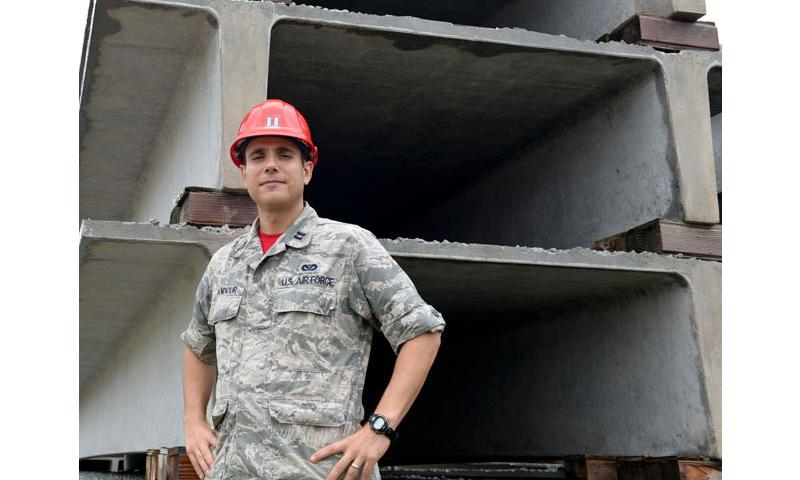 Capt. Naseem Ghandour, 554th RED HORSE Squadron Engineering Flight deputy commander, poses beside double-tee beams Jan. 16, 2015, in Yigo, Guam. Ghandour was recognized through the Every Dollar Counts program after he saved the Air Force more than $235,000. (U.S. Air Force photo by Staff Sgt. Robert Hicks/Released)