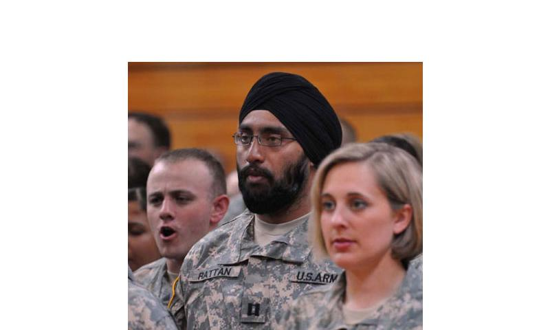 "Capt. (Dr.) Tejdeep Singh Rattan joins his graduating class in singing ""The Army Goes Rolling Along"" during the Basic Officer Leadership Course graduation ceremony in 2010, at Fort Sam Houston, Texas. If requests ""reflect sincerely held beliefs"" and don't harm readiness, unit cohesion or good order and discipline,"" beards, turbans and other signs of spiritual devotion will be approved by the military under a new policy the Pentagon. (Courtesy of U.S. Army)"