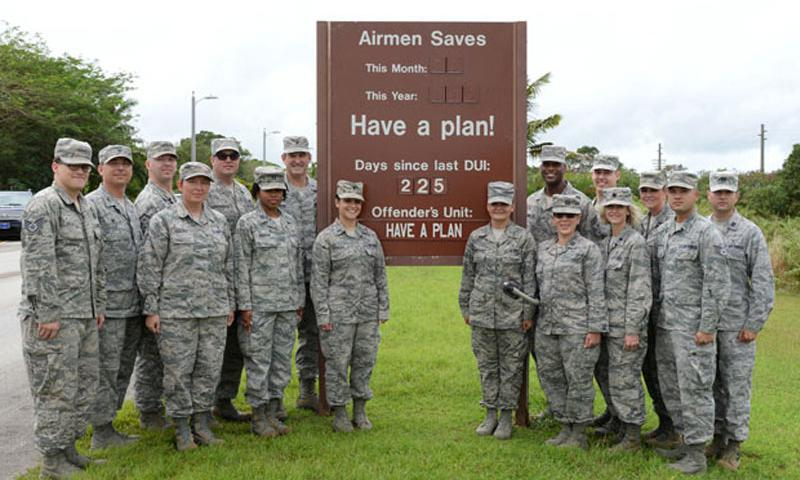 Brig. Gen. Andrew Toth, 36th Wing commander and Chief Master Sgt. Michael McMillan, 36th Wing command chief, pose with members of Team Andersen celebrating 225 days since the base's last DUI incident Jan. 22, 2015, at Andersen Air Force Base, Guam. (U.S. Air Force photo by Senior Airman Cierra Presentado/Released.)