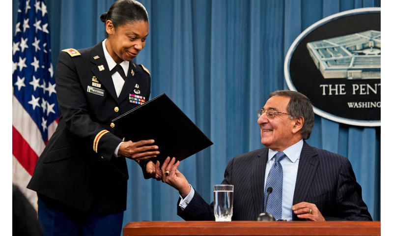 Defense Secretary Leon E. Panetta hands Army Lt. Col. Tamatha Patterson a document he signed during a news conference at the Pentagon, Jan. 24, 2013, to lift the Defense Department's ban on women in direct ground combat roles. DOD photo by Erin A. Kirk-Cuomo