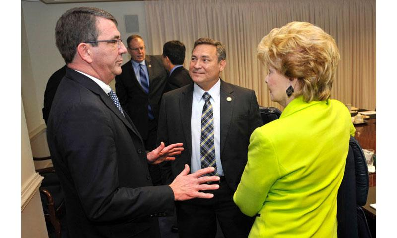 Then-Deputy Secretary of Defense Ash Carter, left, meets with Guam Gov. Eddie Calvo and Delegate Madeleine Z. Bordallo at the Pentagon in 2013. Calvo has ordered the Guam EPA to test the island for traces of Agent Orange. (GLENN FAWCETT/DEFENSE DEPARTMENT)