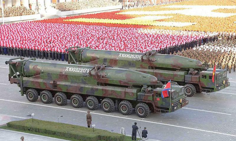 This screenshot from the Korean Central News Agency shows a new version of North Korea's KN-08 intercontinental ballistic missile, publicly displayed during an October military parade. A Japanese government official says the North could launch a long-range ballistic missile as early as next week, according to Japan's Kyodo news agency. (Courtesy of KCNA)