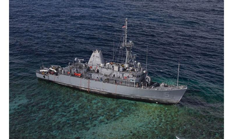 The USS Guardian sits aground on the Tubbataha Reef in the Philippines, Jan. 22, 2013. The Navy announced that the minesweeper will require sectional dismantling to remove it from the World Heritage Site. Geoffrey Trudell/U.S. Navy, Flickr