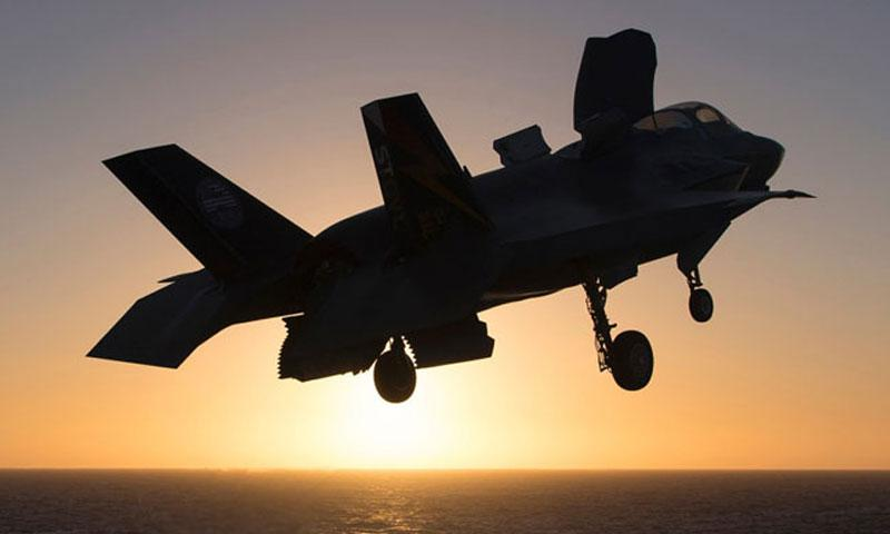 In an October, 2016 file photo, a Lockheed Martin F-35B Lightning II aircraft is silhouetted against the sun during landing exercises on the amphibious assault ship USS America. (©LOCKHEED MARTIN)