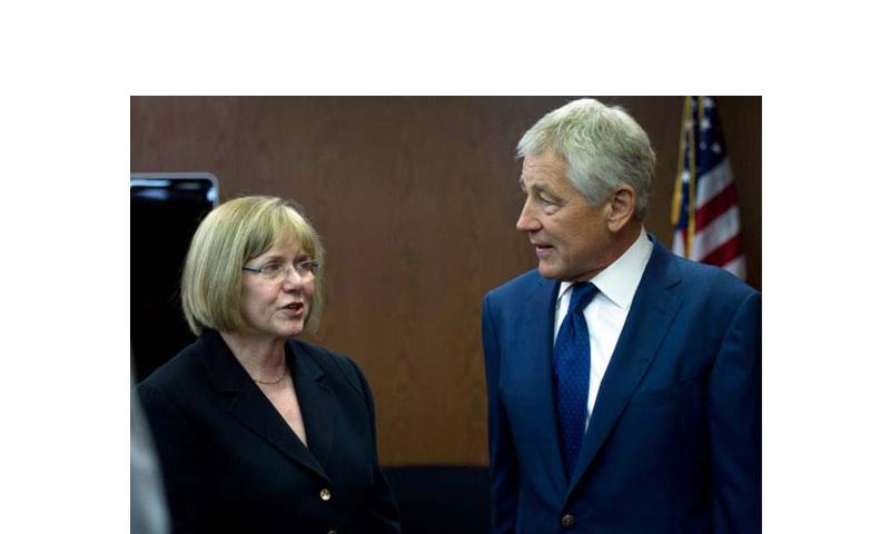 Secretary of Defense Chuck Hagel speaks with Judge Barbara Jones of the Sexual Assault Response Systems Panel, prior to a meeting at the E. Barrett Prettyman Federal Courthouse in Washington D.C., June 27, 2013. (Erin A. Kirk-Cuomo/DOD file photo)