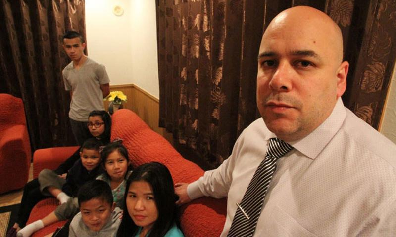 Retired Marine Chris Garcia, seen here with his wife, Natalie, and their 5 children, was promised housing allowance when he was offered a job on Okinawa. After more than 2 years on the job, Garcia has been notified that he was given the benefit in error and that he would be responsible for refunding more than $100,000 in back rent and utilities.