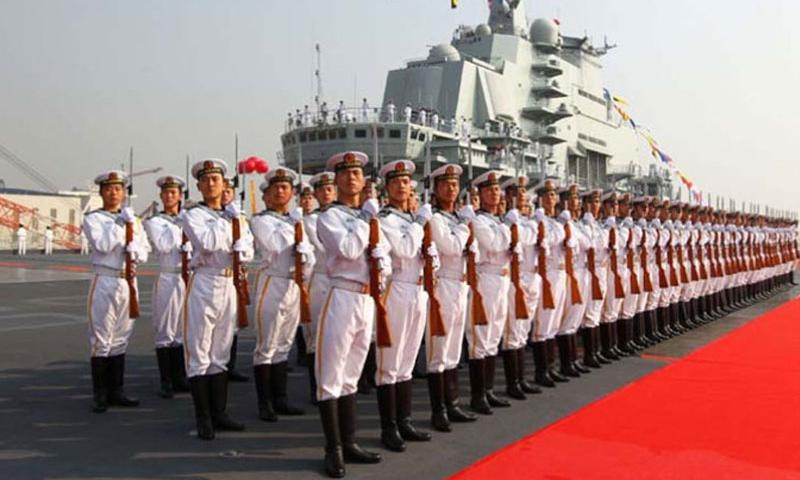 In this photo provided by China's Xinhua News Agency, military officers stand onboard China's aircraft carrier Liaoning in Dalian, northeast China's Liaoning Province, on Sept. 25, 2012. (Zha Chunming, Xinhua)