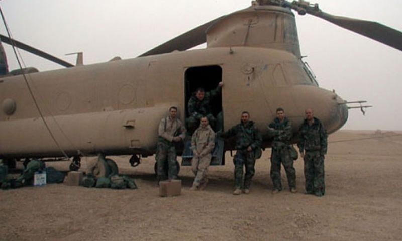 The crew of one of the three stricken Chinook helicopters poses after their safe landing. They are (from left) Sgt. Lance Reynolds, 29, the flight engineer; Staff Sgt. Michael O'Keefe, 33, the door gunner; Chief Warrant Officer 2 Randy Summerlin, 31, the jump-seat pilot; Chief Warrant Officer 3 Dan Helus, 37, the pilot-in-command; Chief Warrant Officer 2 Clay Rekow, 27, the right-seat pilot; and Sgt. Kevin Ellison, 26, the crew chief. (Courtesy of U.S. Army)