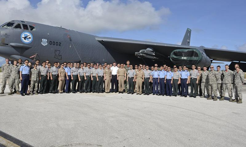 More than 100 Republic of Korea generals and admirals taking part in a Korean National Defense University program take a group photo in front of a 96th Expeditionary Squadron B-52 Stratofortress as part of a visit to Andersen Air Force Base, Guam, Jan. 23 and Jan. 30, 2015. The course, which is designed for newly appointed flag officers, educates participants on key issues and capabilities of allied nations in the Pacific. (U.S. Air Force photo by Staff Sgt. Robert Hicks/Released)