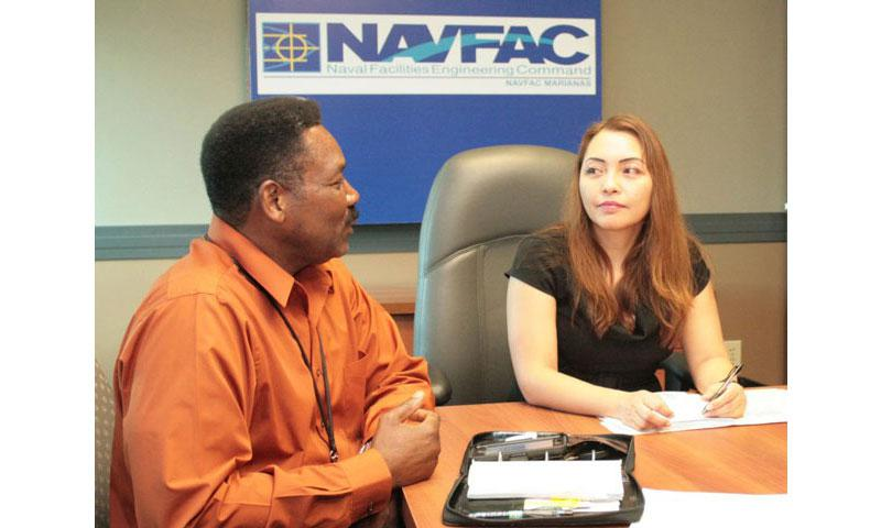 ASAN, Guam - NAVFAC Marianas Business Director Dr.Samuel V. Roundtree discusses the LDP timeline with Contract Specialist Roanna Peredo during an orientation Feb. 1 at the NAVFAC Marianas headquarters building on Nimitz Hill. (NAVFAC Marianas Public Affairs Office/Released)