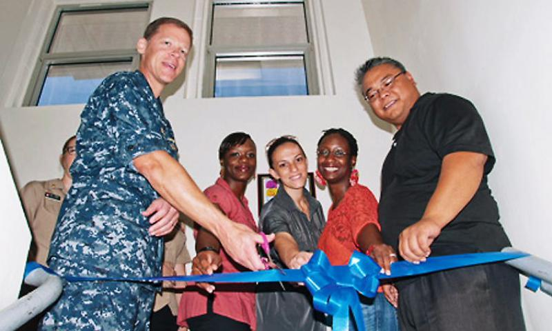 Ribbon-Cutting: Capt. Mike Ward, U.S. Naval Base Guam commanding officer, opens the Volunteer Income Tax Assistance (VITA) Tax Center during a ribbon-cutting ceremony on the base, Feb. 5.  The VITA Tax Center offers free tax services for service members and their families. U.S. Navy photo by Shaina Marie Santos/Released