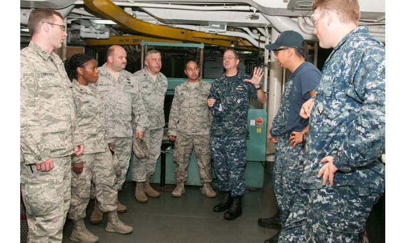 SANTA RITA, Guam (Feb. 8, 2017) Lt. Cmdr. Stephen Fisher, a command chaplain aboard the submarine tender USS Frank Cable (AS 40), introduces Airmen from Joint Region Marianas (JRM) Religious Ministry Team to Sailors during a ship tour, Feb. 8. (U.S. Navy photo by Mass Communication Specialist Seaman Heather C. Wamsley/Released)