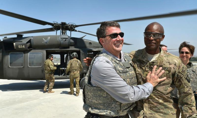 Then-Deputy Secretary of Defense Ash Carter hugs then Brig. Gen. Ron Lewis, in Jalalabad, Afghanistan, on May 13, 2013. Lewis, who would subsequently rise to the 3-star general rank before being stripped of one star in November 2015, lost a second star, the Army announced Thursday, Feb. 9, 2017. (GLENN FAWCETT/DEFENSE DEPARTMENT)