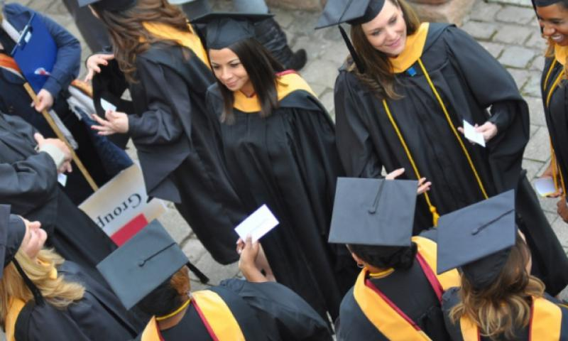 About 200 graduates participated in the University of Maryland University College commencement ceremony last spring in Kaiserslautern, Germany. UMUC announced on Thursday, Feb. 9, 2017, that it will continue to offer classes to U.S. troops in the Middle East and Africa. (JENNIFER H. SVAN/STARS AND STRIPES)