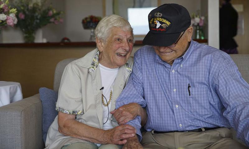 In this Wednesday, Feb. 10, 2016 photo released by Air New Zealand, World War II veteran Norwood Thomas, 93, from the U.S. reunites with his wartime girlfriend Joyce Morris of Australia, in Adelaide, Australia, after more than 70 years apart. Morris was a 17-year-old British girl and Thomas was a 21-year-old paratrooper when they first met in London shortly before D-Day. (Air New Zealand via AP)