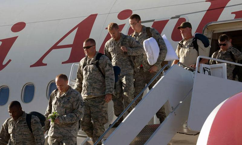 Airmen returning from their deployment step off the plane and are welcomed home at Ellsworth Air Force Base, S.D., Feb. 12, 2017. Ellsworth Airmen conducted integrated bomber training and missions in the maritime domain demonstrating our commitment to deterrence, offering assurance to our allies, and strengthening regional security and stability in the Indo-Asia-Pacific region. (Photo by Airman 1st Class Donald Knechtel)