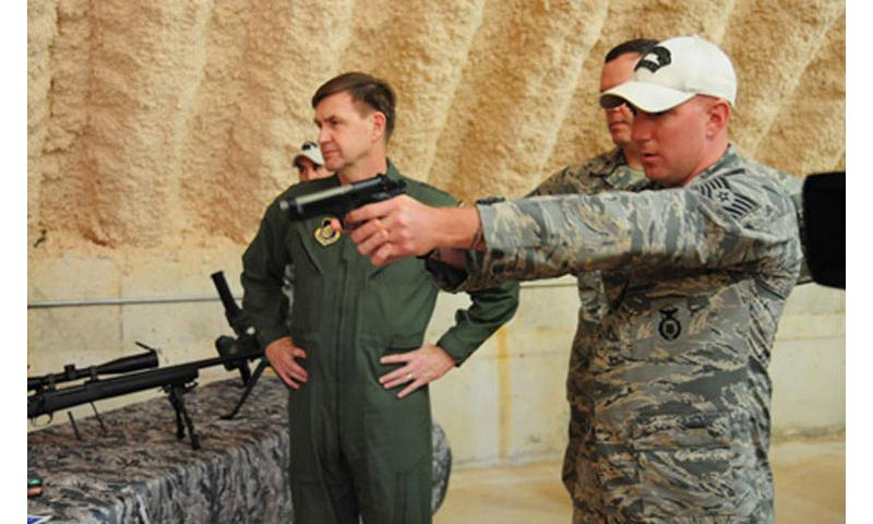 Demonstration: Tech. Sgt. Michael Dugan, 736th Security Forces Squadron (SFS), fires a 9 mm pistol with simulated rounds demonstrating different techniques to control a suspect to Lt. Gen. Stephen Hoog, 11th Air Force commander, demonstrating different techniques to control a suspect at Andersen Air Force Base (AFB) at Northwest Field, Guam, Feb. 1. (U.S. Air Force photo by Senior Airman Robert Hicks/Released)