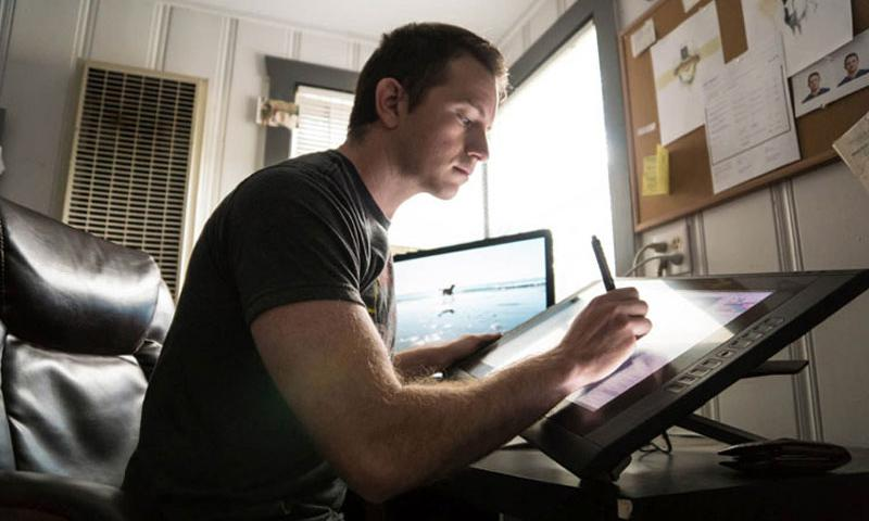 "Marine veteran Maximilian Uriarte, who served in the Iraq War, works on a ""Terminal Lance"" comic strip. The strip has become part of the fabric of the Marine Corps through Uriarte's satirization of Marine grunt and military life. (Courtesy of Maximilian Uriarte)"