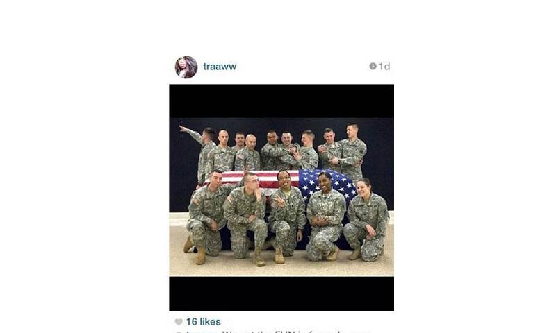 Screenshot of Wisconsin National Guard member Spc. Terry Harrison's post of soldiers mugging as they stood around a casket draped in a flag. (Instagram)