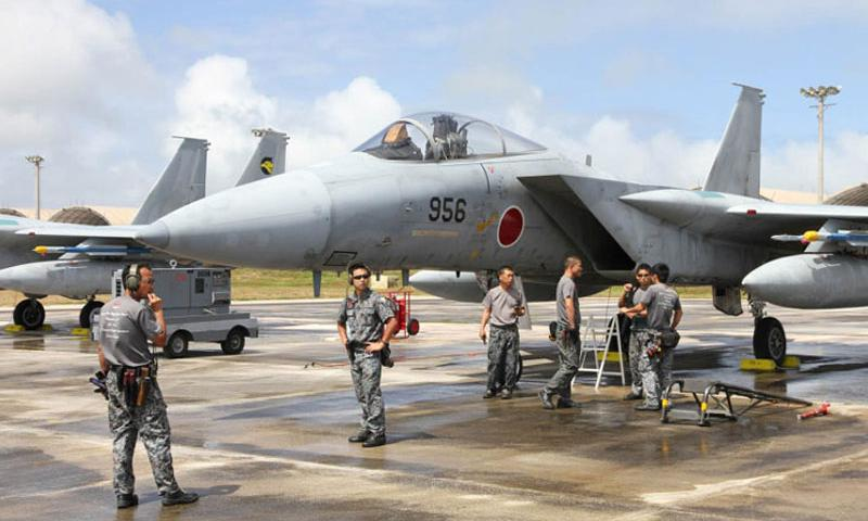 A maintenance crew readies a Japan Air Self-Defense Force F-15 fighter jet for Cope North training, Wednesday, Feb. 17, 2016, at Andersen Air Force Base, Guam. Aircraft from the U.S. Air Force and Navy, Japan and Australia are being used for the disaster-relief and combat-readiness drills, which kicked off last week and run through Feb. 26. (Wyatt Olson/Stars and Stripes)