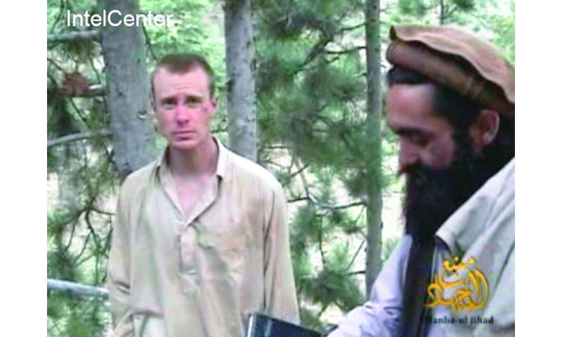 This picture shows a frame grab from a video released by the Taliban containing footage of a man believed to be Bowe Bergdahl, left. Captured in 2009, Bergdahl was released by the Taliban in May 2014. (AP)