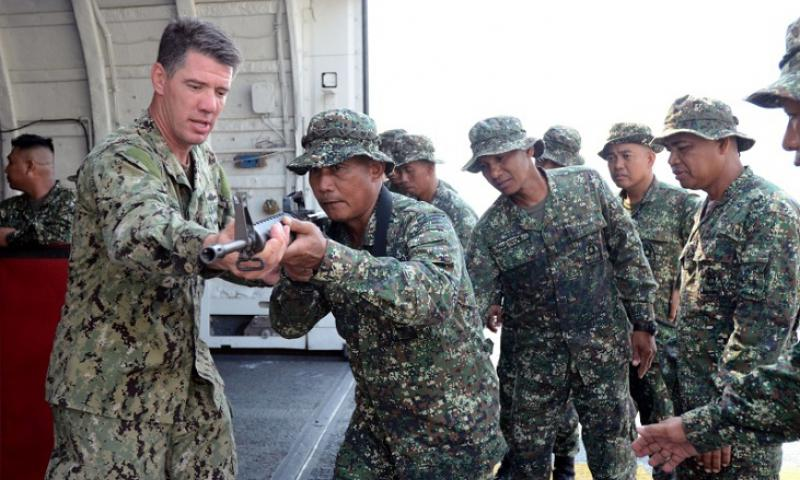 A Navy sailor teaches visit, board, search and seizure techniques to Philippine marines during Cooperation Afloat Readiness and Training Philippines 2013 in this June 2013 photo. (Jay C. Pugh/U.S. Navy)