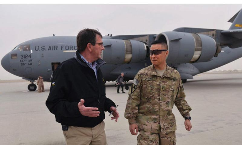 Secretary of Defense Ash Carter is greeted by Brig. Gen. Viet Luong, commander of Train, Assist, Advise Command, south, as he arrives at Kandahar Airfield, Afghanistan, Feb. 22, 2015. (Glenn Fawcett/Department of Defense)