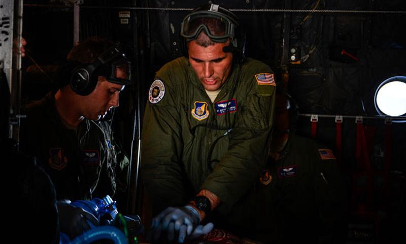 Staff Sgt. Matthew Flowers, an aeromedical evacuation technician with the 18th Aeromedical Evacuation Squadron, performs simulated CPR aboard a U.S. Air Force C-130 Hercules Feb. 15, 2016, during an expeditionary medical support exercise over the Pacific Ocean near Guam. Exercise Cope North 16 enhances humanitarian assistance and disaster relief crisis response capabilities between six nations and lays the foundation for regional cooperation during real-world contingencies in the Indo-Asia-Pacific region.