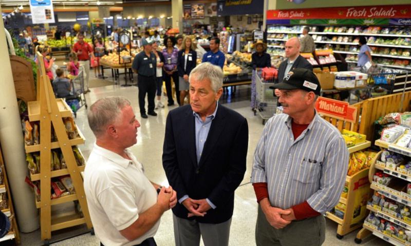 Secretary of Defense Chuck Hagel, center, tours the commissary at Naval Air Station Jacksonville, Fla., July 16, 2013. (Glenn Fawcett/DOD)