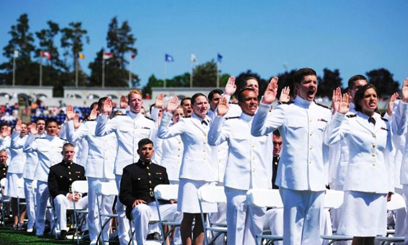 Midshipman from the class of 2012 take the oath of office administered by Chief of Naval Operations Adm. Jonathan Greenert during the 2012 U.S. Naval Academy graduation and commissioning ceremony at the U.S. Naval Academy (Peter Lawlor/U.S. Navy)