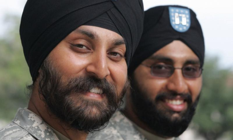 Army Lt. Col. Kamal Kalsi; left; and now-Maj. Tejdeep Rattan were the first two Sikh soldiers to receive an exemption to serve in their religiously-mandated beards and turbans in 2009. The Army has since approved at least 15 additional Sikhs to serve while maintaining their articles of faith; including eight such exemptions in the first two months of 2017. (ALICIA WAGNER CALZADA/PROVIDED BY THE SIKH COALITION)
