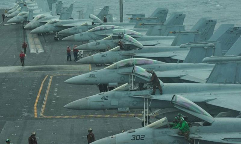 Aircraft line the flight deck of the USS George Washington in the East China Sea in October 2013. Republican White House hopefuls on Thursday, Feb. 25, 2016, are likely to sing a familiar dirge : President Barack Obama has degraded the military. Top defense analysts with combat experience, however, say that refrain is simplistic and fails to include other parties they hold responsible for current military problems, including the Pentagon itself. (Liam Kennedy/U.S. Navy)